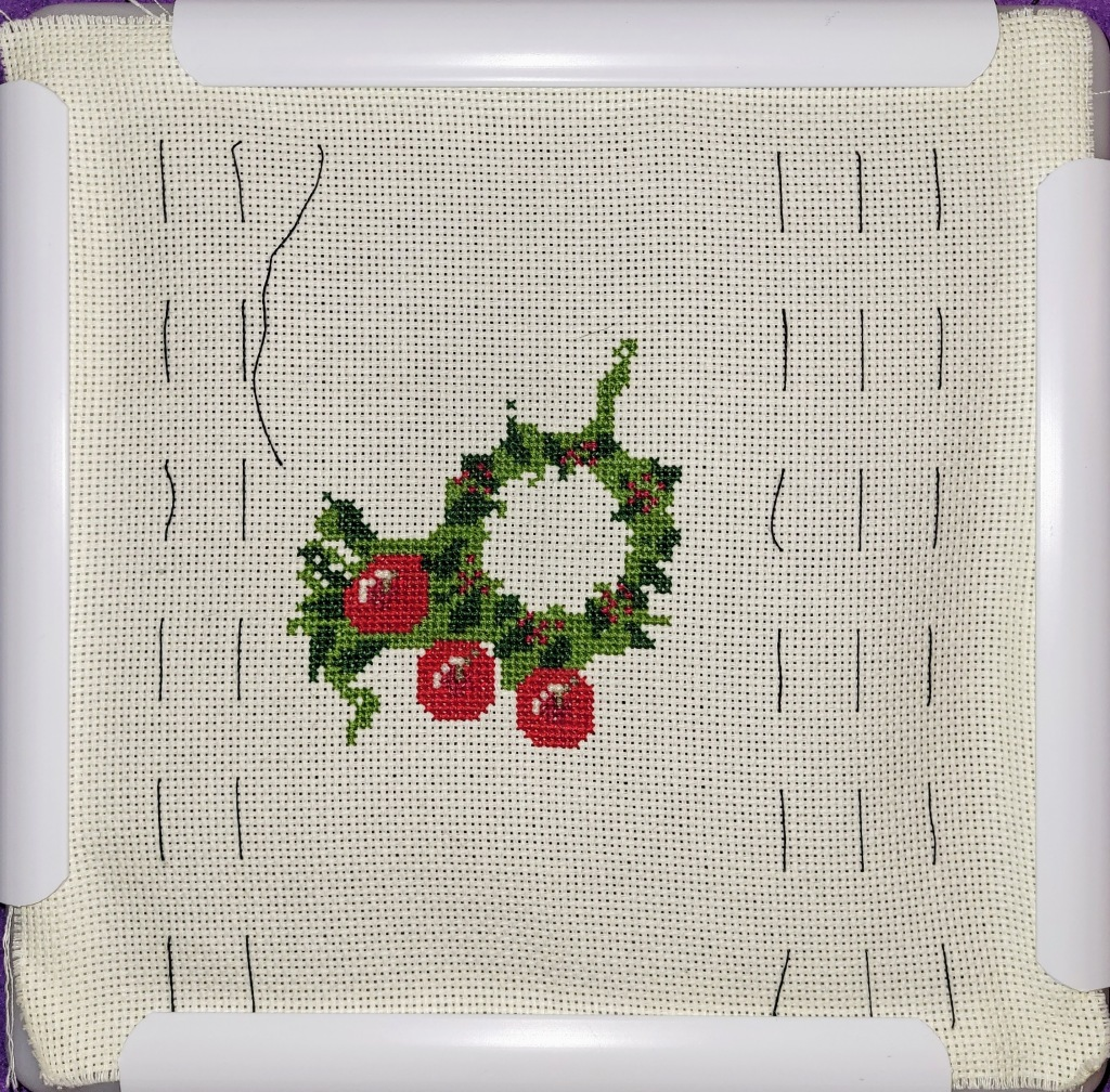 Progress on Christmas Wreath cross stitich, center ring on of greens done, and 3 apples