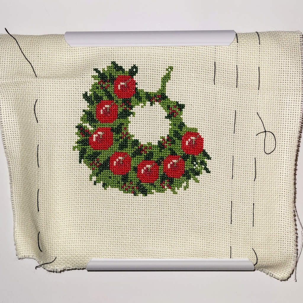 Christmas wreath cross stitch, approximately 2/3 complete